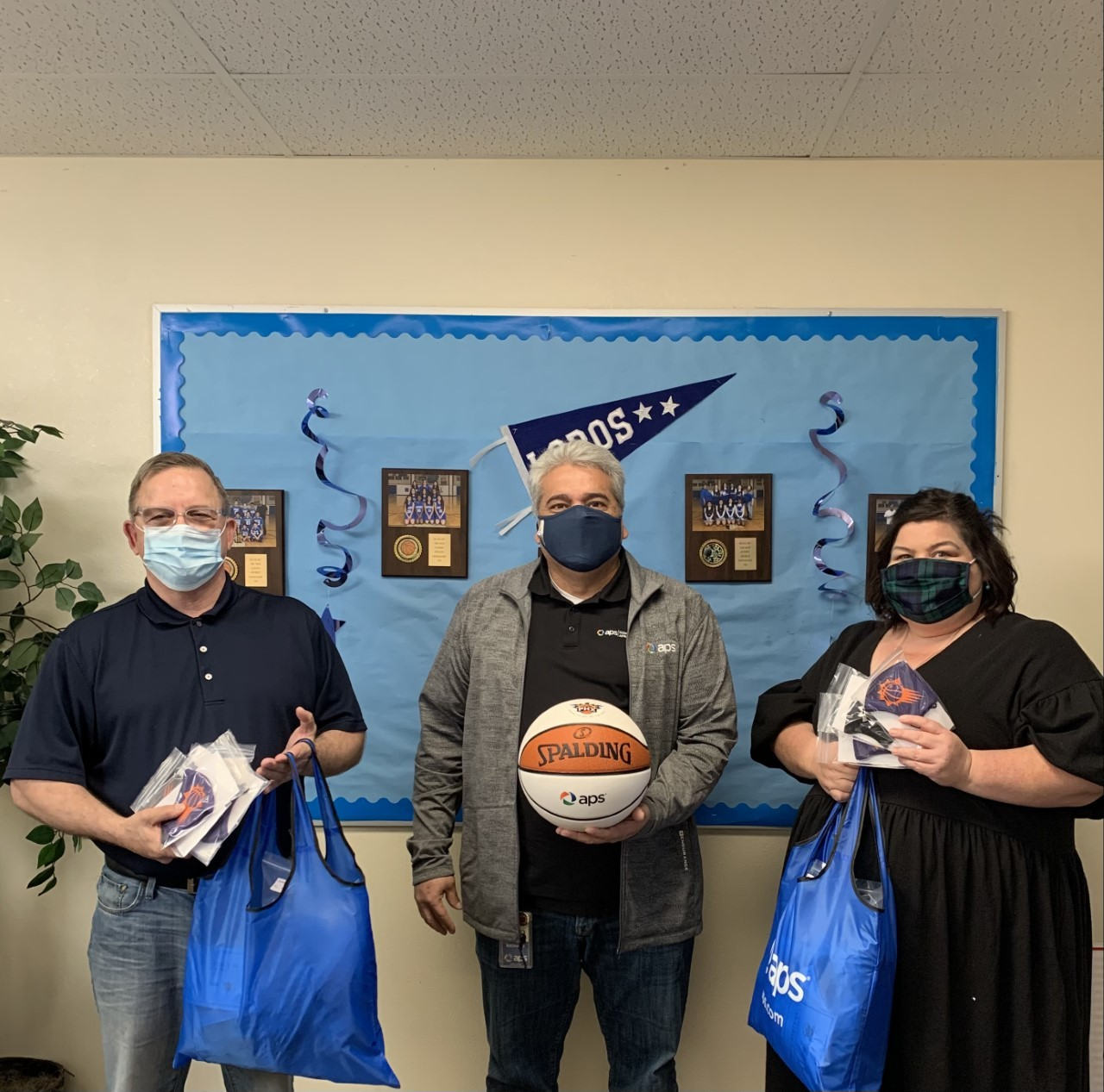 Mr. Jeff Gregorich and Pamela Gonzalez with Richard Rosales, Community Affairs Manager with APS donating ASU face masks and basketball to Leonor Hambly K-8.!